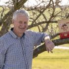John Newlands with a bag of Radical Dog, the tart cherry dog food. PHOTO: SUPPLIED/SHOPBOX