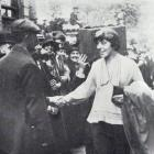 Mrs Edgar Lansbury, councillor of the London borough of Poplar, shakes hands with ...