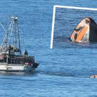 Commercial fishing boat Echo tows the submerged recreational boat back to Carey's Bay after it...