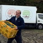 Organic Solutions director and co-founder James Porteous packs a truck with organic vegetables in...