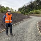 NZ Transport Agency SH88 senior project manager Jason Forbes stands on the  section of shared...