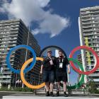 New Zealand weightlifter Laurel Hubbard and coach Callan Helms stand in front of the Olympic...