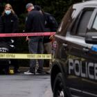 Law enforcement officers collect evidence near the scene of the shooting at the Boise Towne...