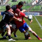 Ross Braude of Canada battles for the ball with Alfonso Escobar of Chile during a match as part...