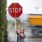 Chanelle Hayes indicates the recommended size a rural road stop sign should be at the Outram...