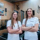Dunstan High School rowers Sophie Smith (left) and Mackenzie Ealson take a break from training in...