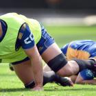 Dylan Nel takes the ball to ground as Freedom Vahaakolo watches at an Otago training session at...