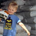 Charlie Hughes (5)  lifts a sack of sheep pellets at Wal's Plant Land, in Mosgiel, yesterday...