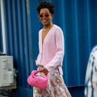 A printed maxi dress is styled with a soft pastel oversized cardi and accessorised with flashes...
