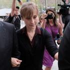 Actor Allison Mack, known for her role in the TV series Smallville, leaves the United States...