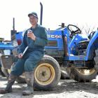 Outram farmer Graeme Young takes  time to stop and smell the coffee at an auction of farm...