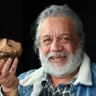 Miner and geologist Harry Albert, of Milton, holds what he believes may be a meteorite,...