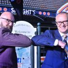 Dunedin MP Dr David Clark (right), then the health minister, celebrates the opening of a Covid-19...