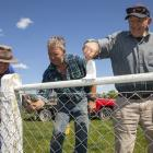 David Adams, Andrew Benny and Gordon Michael paint a fence at the Ellesmere Showgrounds. Photo:...