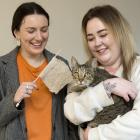 Holding the remains of her stolen knitting is Georgia Clarke (left) with Alex McNair and her...
