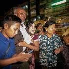 People react outside Insein prison as Myanmar's Junta releases prisoners including people that...