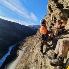 Abseilers (from left) Wayo Carson, Paul Chin and Pete Brown (legs) sit tight earlier this year...