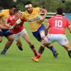 North Otago co-captain Manulua Taiti fends off Poverty Bay's defence during the Heartland...