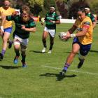 North Otago winger Mataroa Maui on his way to scoring the Old Golds' first try. PHOTO: KAYLA HODGE