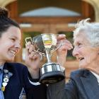 Holding up the Anna P Logan Stout Challenge Cup is Otago Girls' High School head girl Jemma...