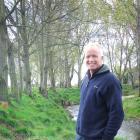 North Otago cropping farmer Peter Mitchell views native plantings beside the Waiareka Creek....