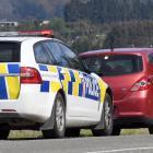 Senior Constable Brent Christie tickets a speeding driver on State Highway 1 near Waitati.PHOTO:...