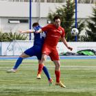 outh City Royals midfielder Olivier Cassidy (front) goes up for the ball with Christchurch United...