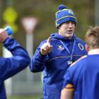 Coach Tom Donnelly talks to the Otago team at training at Logan Park. PHOTO: PETER MCINTOSH