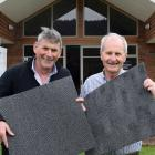 Exhibiting wool carpet tiles before speaking at a roadshow stop at Lawrence Golf Club last week...