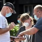 Bruce Hayman (left) takes details from Harper Wilson (12) and his dad Steve Wilson, during the...