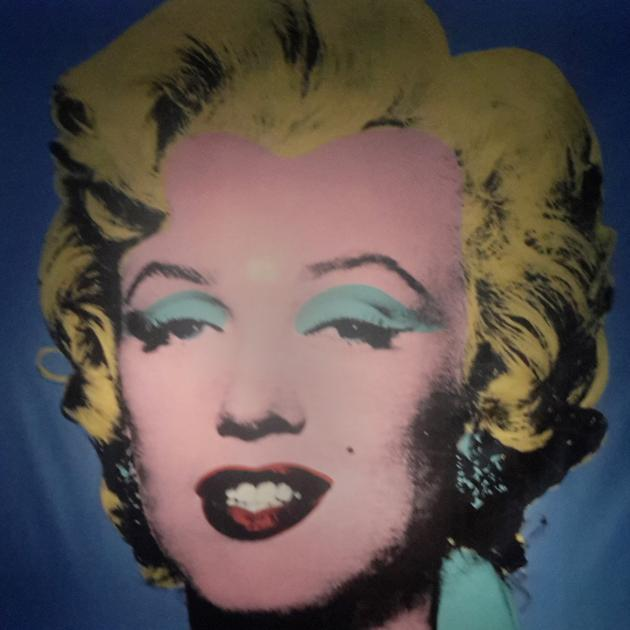 Marilyn Monroe stares down from the wall in the entrance to Andy Warhol exhibition in Rome.PHOTO:...