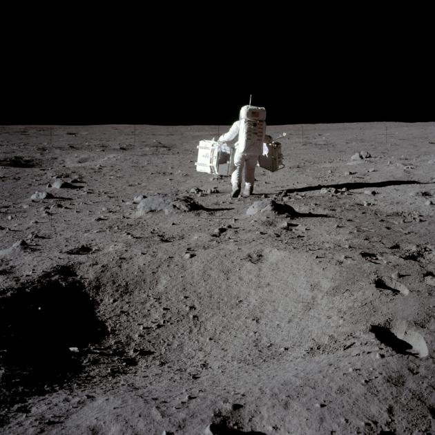 Buzz Aldrin carries equipment for experiements carried out at Tranquility Base in the Sea of...
