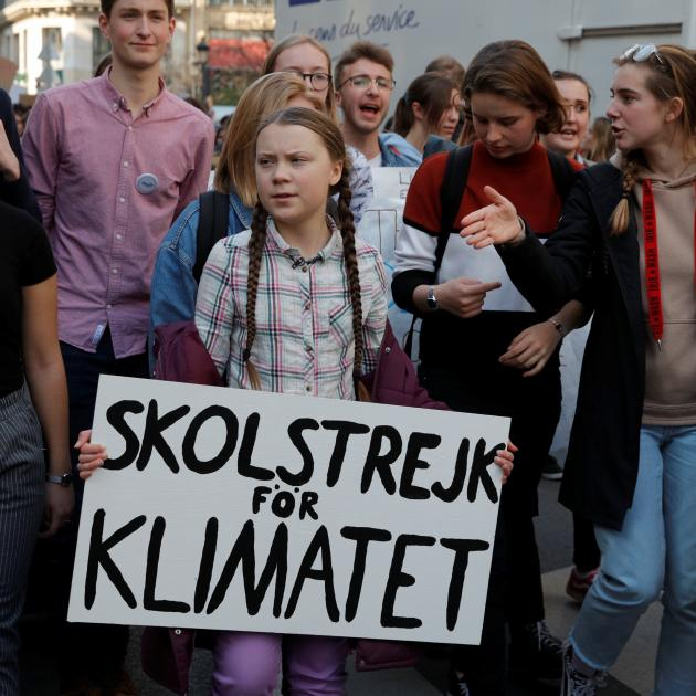 Swedish environmental activist Greta Thunberg (16, centre) takes part in a protest calling for...