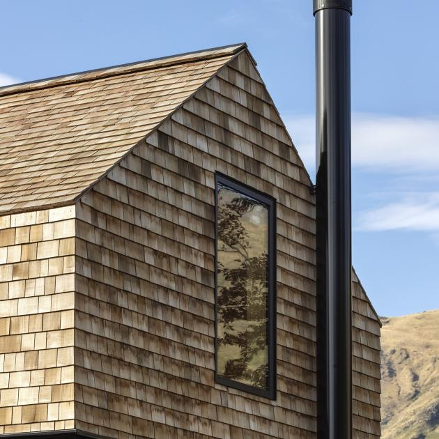Using a single material on the roof and walls made for a clean and seamless exterior. The house...