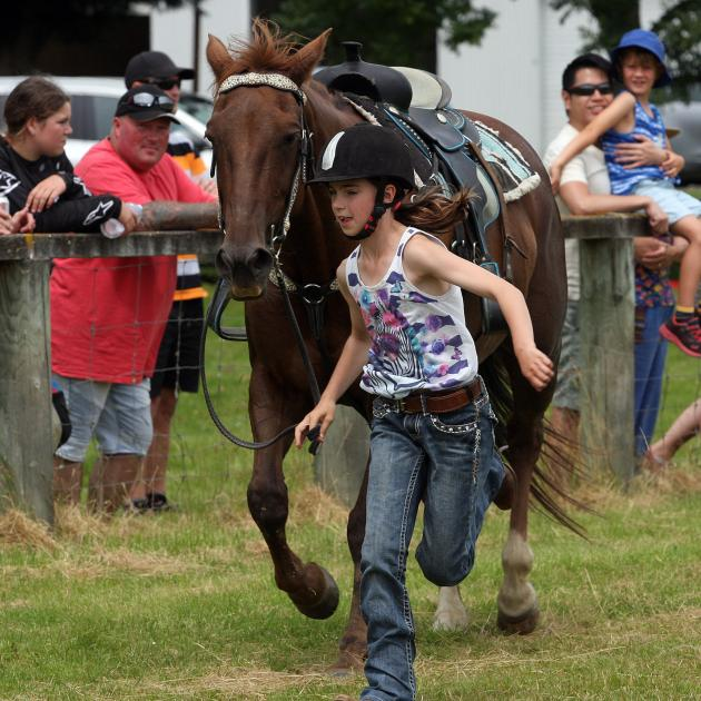 Caitlyn Forde, of Balclutha, leads Breeze home in her walk trot lead agility race at the Lawrence...