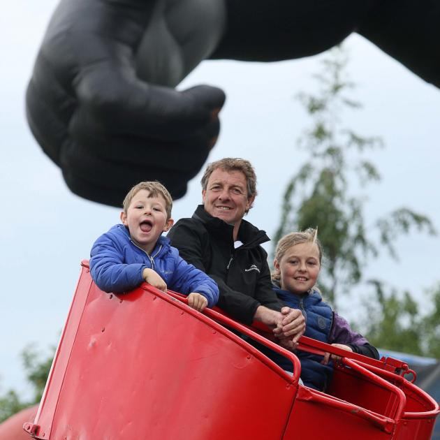 The Clark family from Milton  father Bryce and son Thomas (6)  and daughter Lucy (10) ride the...