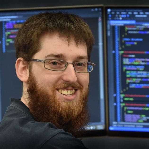 "RocketWerkz programmer James Hannam, originally of Auckland, says life with gigabit internet speeds in Dunedin is ""great"". Photo by Peter McIntosh."