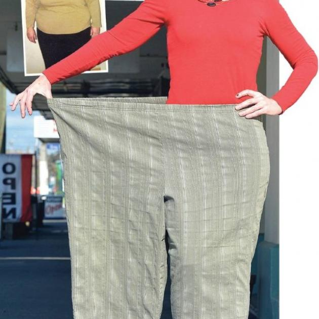 Weight Watcher Sue O'Sullivan, of Milton, models the trousers she used to wear. Photo by Stephen Jaquiery