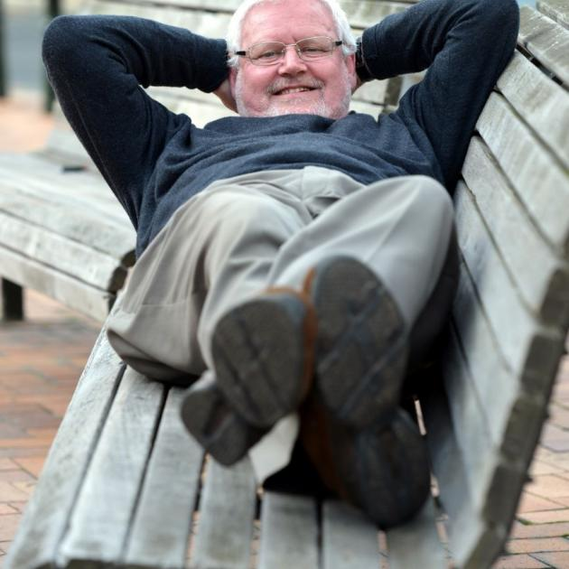 Dunedin Night Shelter Trust chairman Dave Brown tests the benches in the Octagon. He, along with trust board member John Le Brun and Labour MP  David Clark, will be ''sleeping rough'' in the Octagon on Sunday night to raise money for the night shelter. Ph