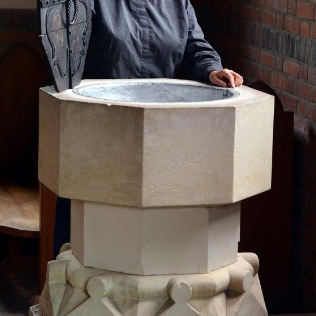 Milton-Tuapeka vicar the Rev Vivienne Galletly with the font in the soon-to-be decommissioned Church of the Holy Trinity in Lawrence. Photo by Stephen Jaquiery.