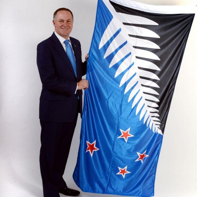 John Key with the winning flag. Photo: Gerard O'Brien