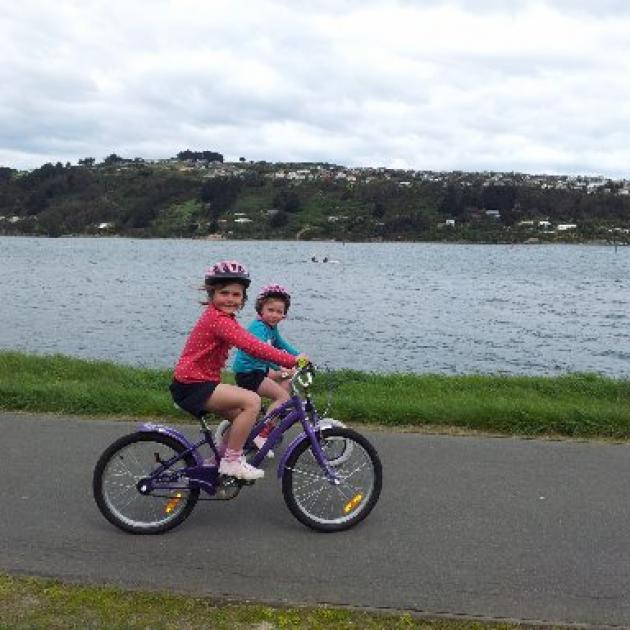 Sisters Georgia (then 6) and Matilda Hall (then 5) enjoy a ride on the West Harbour cycleway in 2013. They learnt to ride on the track and still enjoy going back for a pedal, now on bigger bikes. Photo by John Fridd