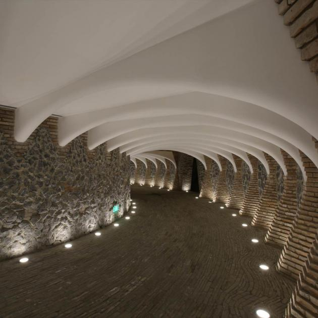 A subterranean entrance to the Marisfrolg Headquarters made from concrete, recycled bricks and...