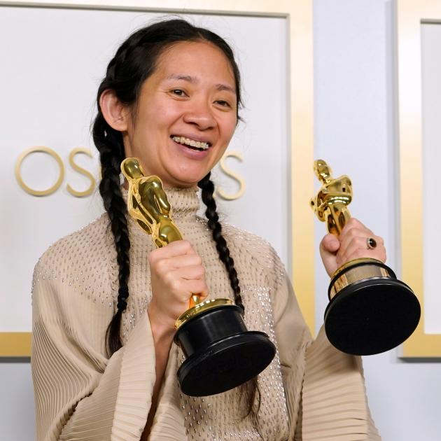 Chloe Zhao with her Academy Awards for Best Picture and Best Director. Photo: Reuters