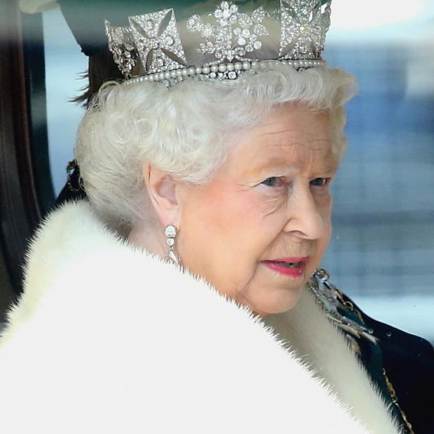 The Queen dressed in white fur for the Sate Opening of Parliament. Photo: Getty Images