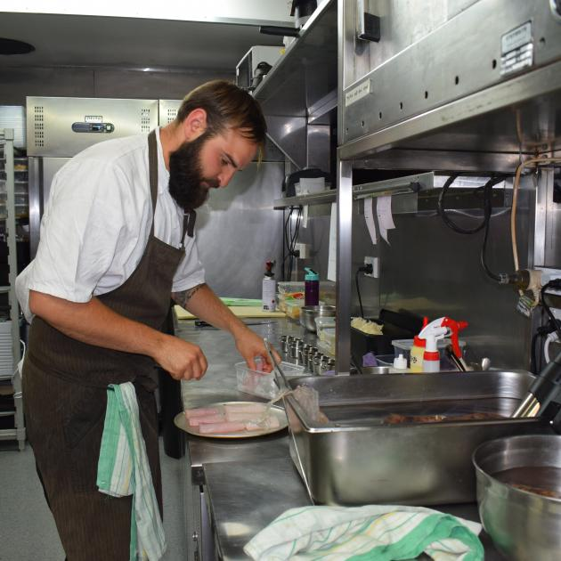 Ode chef Lucas Parkinson prepares a fish dish in the test kitchen. Photos: Kerrie Waterworth.