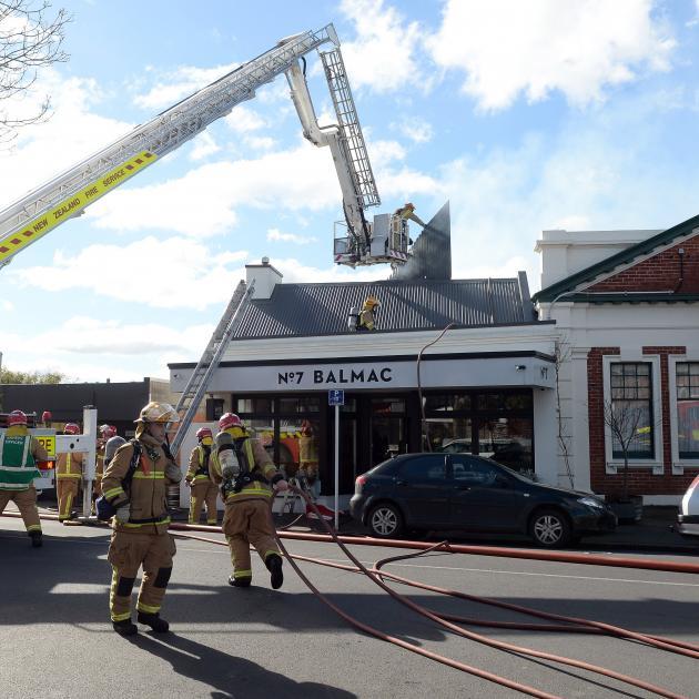 Firefighters rip open the roof of popular Dunedin restaurant No7 Balmac to battle a blaze there...