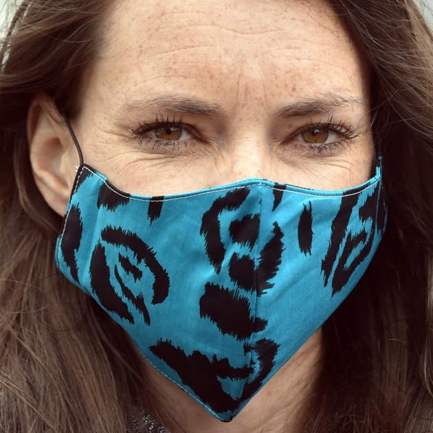 Esther Paterson dons a compulsory face mask for public transport travel at the Bus Hub in Dunedin.