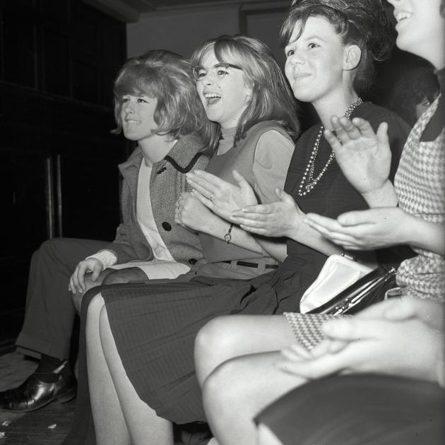 Unidentified young women react to The Beatles on stage in Dunedin.