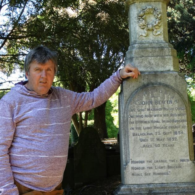 Dunedin historian Peter Trevathan pictured with the grave of John Bevin, who survived the Charge...